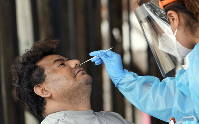 A man is tested at a free coronavirus testing site, provided by United Memorial Medical Center on June 28, 2020, at the Mexican Consulate, in Houston, Texas. (AP Photo/David J. Phillip)