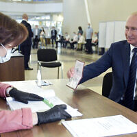 Russian President Vladimir Putin arrives to take part in voting at a polling station in Moscow, Russia on July 1, 2020. (Alexei Druzhinin, Sputnik, Kremlin Pool Photo via AP)