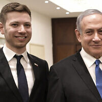 Prime Minister Benjamin Netanyahu and son Yair in Tel Aviv, January 23, 2020. (Aleksey Nikolskyi/Sputnik Kremlin Pool Photo via AP)