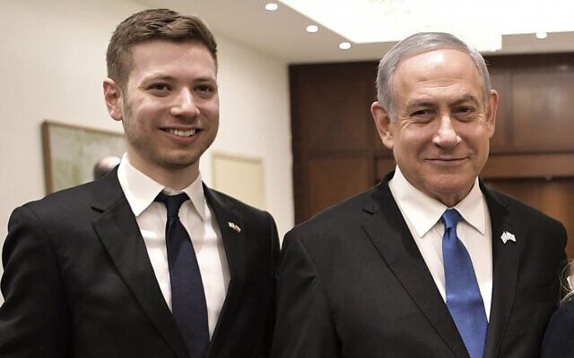 Prime Minister Benjamin Netanyahu (R) and son Yair in Tel Aviv, January 23, 2020. (Aleksey Nikolskyi/Sputnik Kremlin Pool Photo via AP)