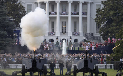"President Donald Trump and first lady Melania Trump watch as a 21-gun salute by the Presidential Salute Battery, 3d U.S. Infantry Regiment (The Old Guard), is fired by canons on the Ellispe during a ""Salute to America"" event on the South Lawn of the White House, Saturday, July 4, 2020, in Washington. (AP/Alex Brandon)"