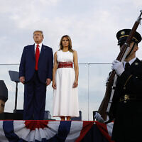 "US President Donald Trump and first lady Melania Trump stand onstage during a ""Salute to America"" event on the South Lawn of the White House, Saturday, July 4, 2020, in Washington. (AP/Patrick Semansky)"