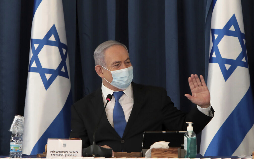 Prime Minister Benjamin Netanyahu wears a face mask to help prevent the spread of the coronavirus as he chairs the weekly cabinet meeting, at the Foreign Ministry, in Jerusalem, July 5, 2020. (Gali Tibbon/Pool via AP)