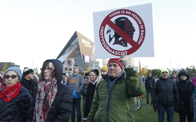 Native American leaders protest against the Redskins team name outside US Bank Stadium before an NFL football game, October 24, 2019. (Bruce Kluckhohn/AP)