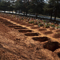 Freshly-dug graves in a row at Johannesburg's main Westpark Cemetery, Thursday, July 9, 2020.(AP Photo/ Denis Farrell)
