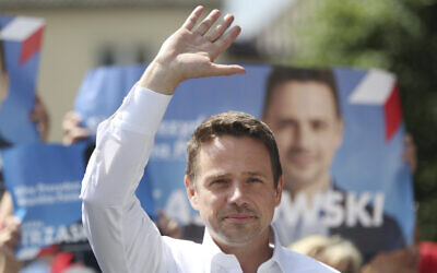 Contender in Poland's key presidential election runoff Sunday, liberal Warsaw Mayor Rafal Trzaskowski greets supporters during a campaign rally, in Raciaz, Poland, on July 9, 2020 (AP Photo/Czarek Sokolowski)