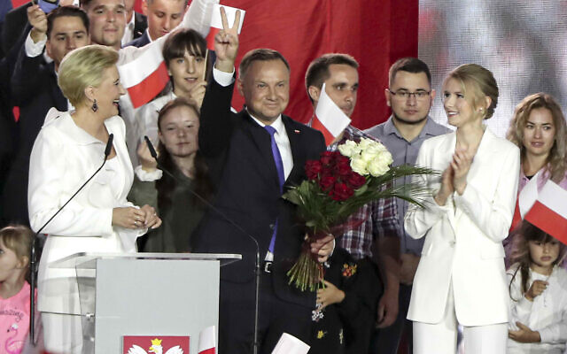 Incumbent President Andrzej Duda flashes a victory sign in Pultusk, Poland, on July 12, 2020. (AP Photo/Czarek Sokolowski)
