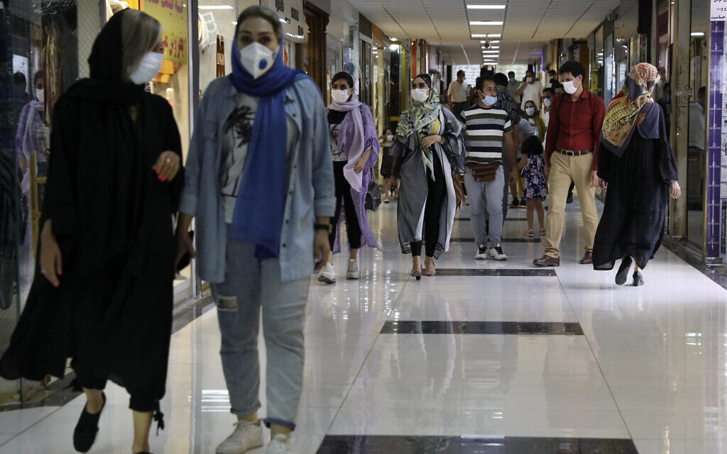 People wearing protective face masks to help prevent the spread of the coronavirus walk through the Nasr Shopping Center in Tehran, Iran, July 15, 2020 (AP Photo/Vahid Salemi)