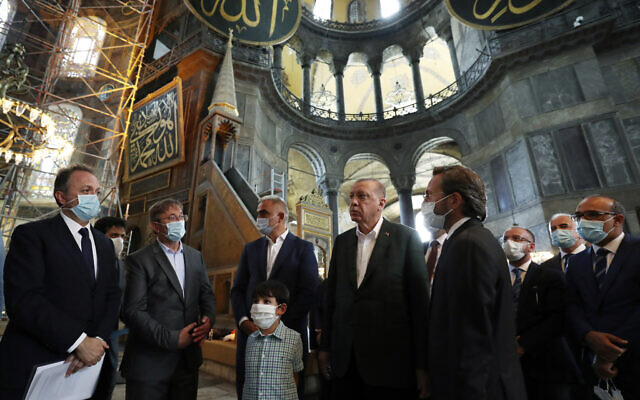 Turkey's President Recep Tayyip Erdogan, center, and other officials visit the Byzantine-era Hagia Sophia, one of Istanbul's main tourist attractions in the historic Sultanahmet district of Istanbul, July 19, 2020, days after he formally reconverted Hagia Sophia into a mosque and declared it open for Muslim worship, after a high court annulled a 1934 decision that had made the religious landmark a museum.(Turkish Presidency via AP, Pool)
