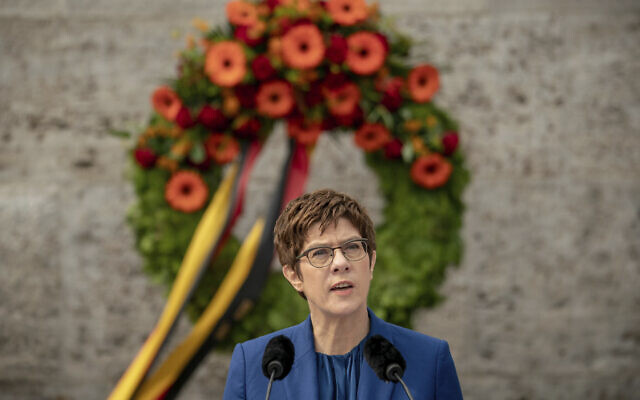 Annegret Kramp-Karrenbauer, German Minister of Defense, delivers her speech at the Ploetzense Lake Memorial in memory of those murdered in the resistance against the Nazis in Berlin, Germany, Monday, July 20, 2020. The day commemorates the failed assassination attempt on Adolf Hitler on July 20, 1944. (Michael Kappeler/dpa via AP)