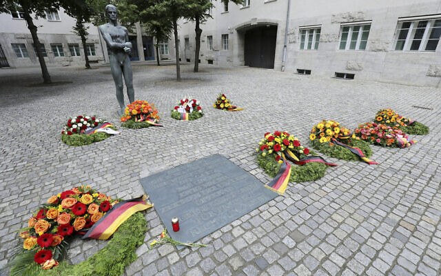 Numerous wreaths and flower arrangements have been laid in the Bendlerblock at the German Resistance Memorial Center on the spot where Claus Graf Schenk von Stauffenberg and other officers were shot in 1944 after the failed assassination attempt on Adolf Hitler, in Berlin, Germany, Monday, July 20, 2020. (Wolfgang Kumm/dpa via AP)