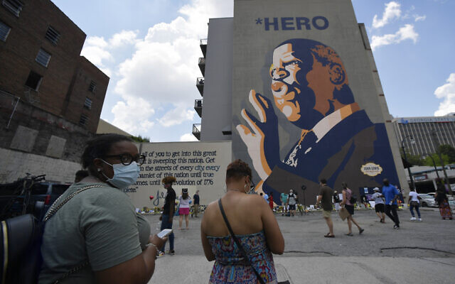 """Rep. John Lewis, D-Ga. , Sunday, July 19, 2020, in Atlanta. Lewis, who died Friday at age 80, was the youngest and last survivor of the Big Six civil rights activists who organized the 1963 March on Washington, and spoke shortly before the group's leader, Rev. Martin Luther King Jr., gave his """"I Have a Dream"""" speech to a vast sea of people. (AP Photo/Mike Stewart)"""