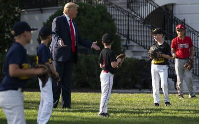 US President Donald Trump greets youth baseball players on the South Lawn of the White House to mark Opening Day for Major League Baseball, Thursday, July 23, 2020, in Washington. (AP/Evan Vucci)