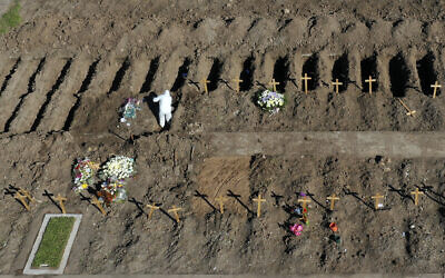Wooden crosses mark freshly dug graves at the Flores cemetery where people who died from the coronavirus are being buried, in Buenos Aires, Argentina, July 25, 2020. (Gustavo Garello/AP)