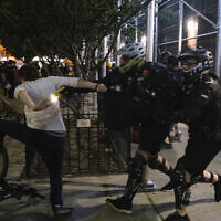 A New York Police Department officer uses a stun gun on a demonstrator during a 'Solidarity with Portland,' protest, July 25, 2020, in New York. (AP Photo/Yuki Iwamura)