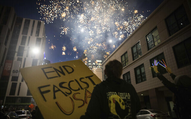 Protesters light fireworks in the middle of downtown Oakland during a protest on July 25, 2020, in Oakland, California (AP Photo/Christian Monterrosa)