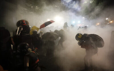 Federal officers launch tear gas at a group of demonstrators during a Black Lives Matter protest at the Mark O. Hatfield United States Courthouse, July 26, 2020, in Portland, Oregon (AP Photo/Marcio Jose Sanchez)