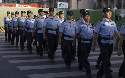Chinese policemen prepare for duty around a neighborhood sealed off before the official closure of the United States Consulate in Chengdu in southwest China's Sichuan province, July 27, 2020 (AP Photo/Ng Han Guan)