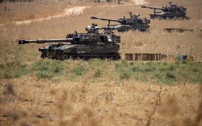 "Israeli mobile artillery units sit in place in northern Israel near the border with Lebanon, July 28, 2020. Israeli security officials said soldiers exchanged fire with a ""Hezbollah terror squad"" to turn back an attempted incursion at the border with Lebanon on Monday. (AP Photo/Ariel Schalit)"