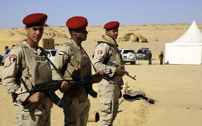 Egyptian Army soldiers stand guard outside the Wati El Hitan Fossils and Climate Change Museum, a UNESCO natural World Heritage site, on January 14, 2016. (AP Photo/Thomas Hartwell)
