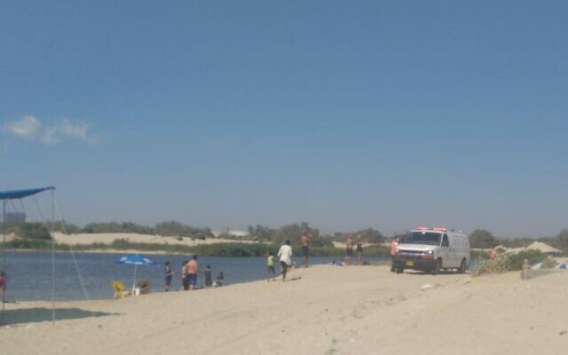 Rescue workers search for a man who went missing after rescuing a mother and her three children from a lake near Zikim beach in southern Israel, July 3, 2020. (Magen David Adom)