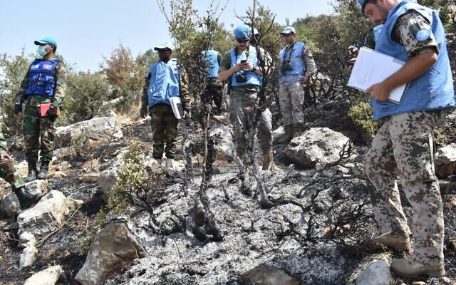 UNIFIL soldiers inspect the remains of a fire caused by IDF munitions during a failed attack on the border from Lebanon on July 29, 2020. (UNIFIL)