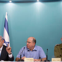 Israeli Prime Minister Benjamin Netanyahu, left, then defense minister Moshe Ya'alon, center, and then IDF chief Benny Gantz at a press conference in Jerusalem on August 27, 2014. (Yonatan Sindel/Flash90)
