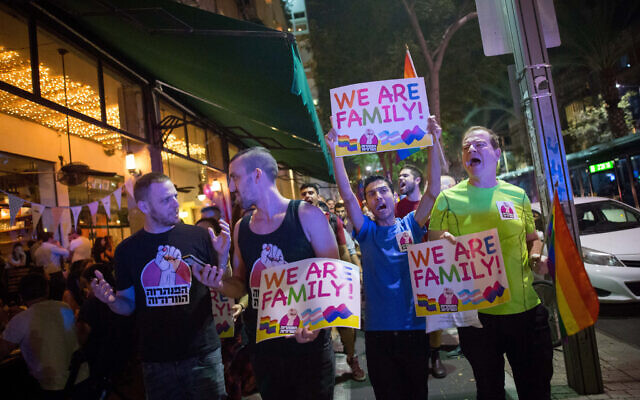 Members of the LGBT community and supporters participate in a protest against a Knesset bill amendment denying surrogacy for same-sex couples, in Tel Aviv on November 1, 2018, 2018. (Miriam Alster/Flash90)