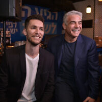Yesh Atid party chairman Yair Lapid seen Idan Roll at a press conference in Tel Aviv, on February 7, 2019 (Flash90)
