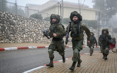 Soldiers from the Golani Brigade take part in a military exercise in the northern city of Safed on February 12, 2020.(David Cohen/Flash90)