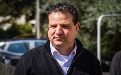 Joint List leader Ayman Odeh speaks to reporters outside his home in Haifa on March 3, 2020. (Flash90)