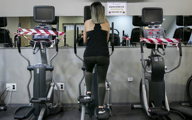 A woman exercises at the Mati gym club in the Malha neighborhood of Jerusalem on May 11, 2020. (Olivier Fitoussi/Flash90)