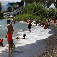 Illustrative -- people enjoy the beaches at the Sea of Galilee, June 19, 2020 (David Cohen/Flash90)