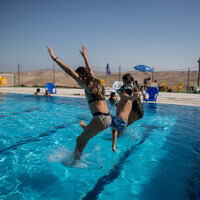 Israeli youth at a swimming pool in the Israeli settlement of Vered Yeriho on July 1, 2020. (Yonatan Sindel/Flash90)