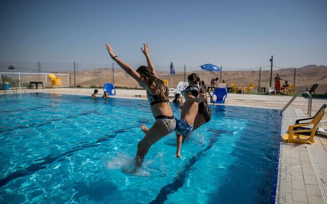 Israeli youth at a swimming pool in the Israeli settlement of Vered Yeriho on July 1, 2020. (Yonatan Sindel/Flash90)