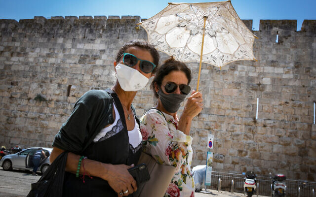 People wearing face masks in Jerusalem  on July 6, 2020. (Olivier Fitoussi/Flash90)