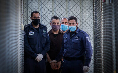 Shaban Titi is brought to the courtroom for his sentence at the Ofer military court near the West Bank city of Ramallah on July 6, 2020. (Flash90)