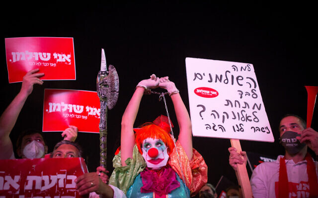 Israelis protest for financial aid at Rabin Square in Tel Aviv on July 11, 2020. (Miriam Alster/Flash90)