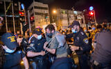 Protesters scuffle with police after a demonstration calling for financial support from the government amid the coronavirus crisis in Tel Aviv on July 11, 2020 (Miriam Alster/Flash90)