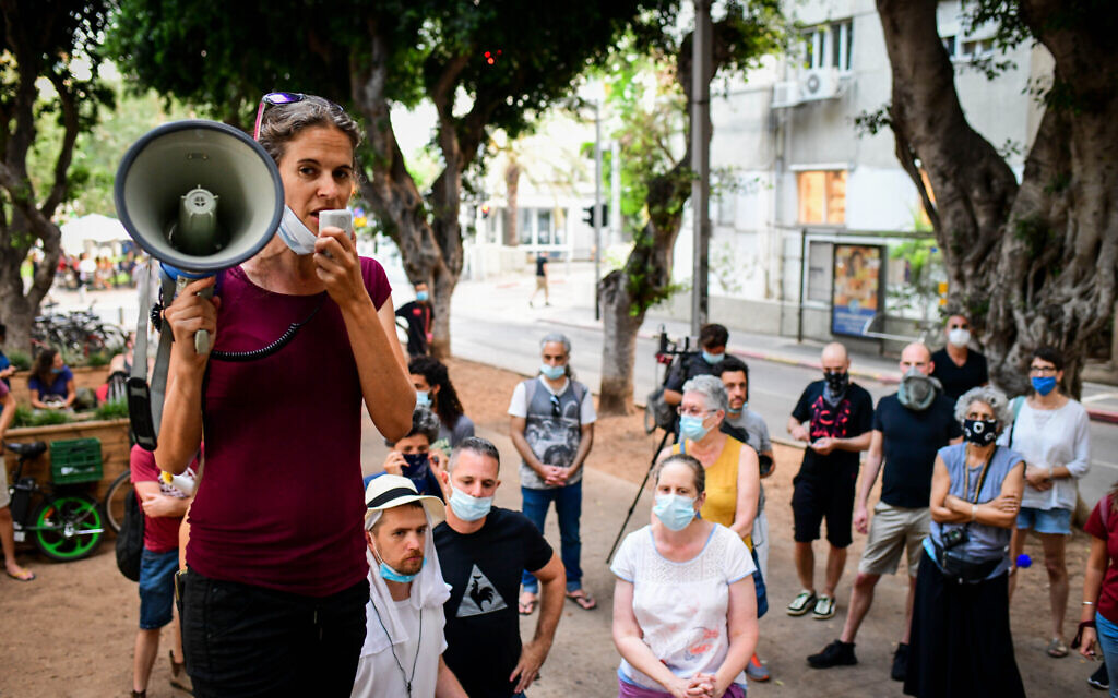 Israelis protest in Tel Aviv, calling for financial support from the government on July 12, 2020. (Avshalom Sassoni/Flash90)