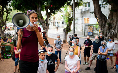 Israelis protest in Tel Aviv, calling for financial support from the government, on July 12, 2020. (Avshalom Sassoni/Flash90)