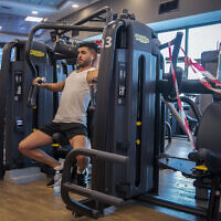 A man exercises at a Modiin gym on July 14, 2020 (Yossi Aloni/Flash90)