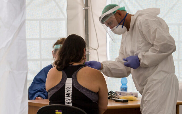 A woman is tested for coronavirus at a site in south Tel Aviv on July 16, 2020. (Flash90)