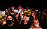 Israelis protest against the government's latest coronavirus restrictions in Tel Aviv on July 18, 2020 (Miriam Alster/Flash90)