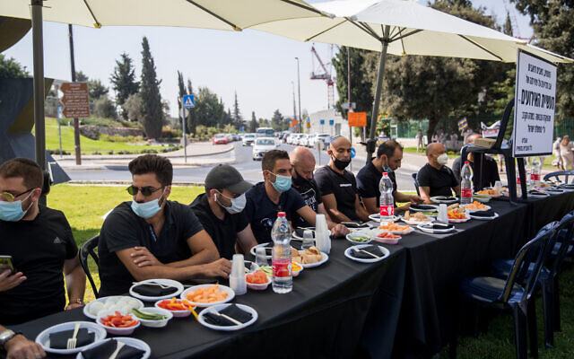 Owners of event halls protest outside the Knesset in Jerusalem to call for financial support from government over restrictions on their businesses due to the coronavirus, on July 21, 2020. (Yonatan Sindel/Flash90)