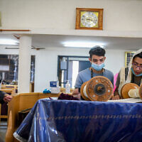 Jewish man and youth pray with face masks at synagogue in Moshav Tzafria, on July 22, 2020. (Yossi Zeliger/Flash90)