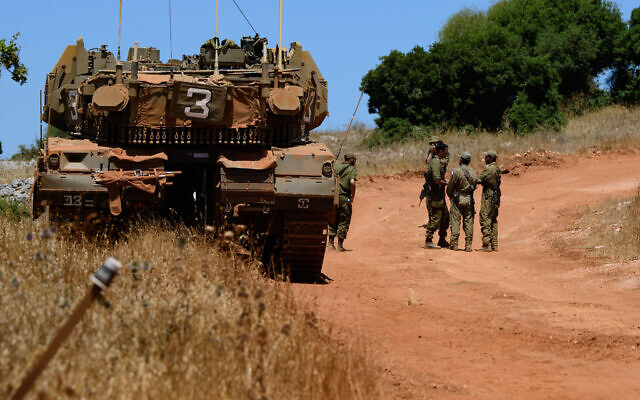 Israel Defense Forces soldiers stationed along the border with Lebanon on July 23, 2020. (Basel Awidat/Flash90)