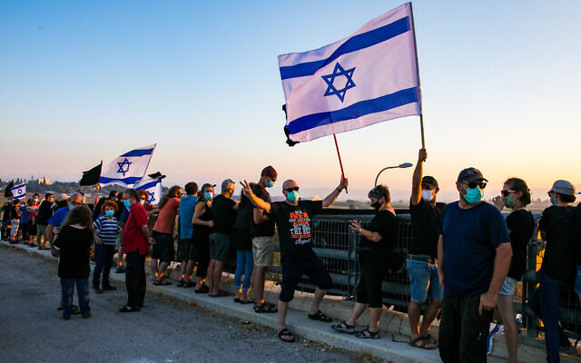 Israelis protest against Prime Minister Benjamin Netanyahu on a bridge in the Jezreel Valley in northern Israel, on July 25, 2020. (Anat Hermony/Flash90)
