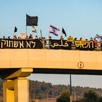 Israelis protest against Prime Minister Benjamin Netanyahu on a highway overpass in the Jezreel Valley on July 25, 2020. (Anat Hermony/Flash90)
