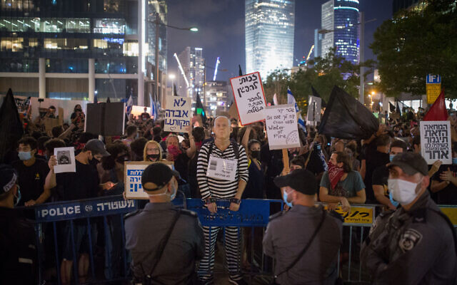 Protesters against Public Security Minister Amir Ohana in Tel Aviv on July 28, 2020. (Miriam Alster/Flash90)